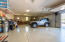 Oversized 4 car garage with beautiful epoxy flooring. Temperature controlled garage.