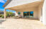Back patio of main home with gorgeous travertine. This is a large patio.
