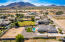 A side ariel view see the mountains and all of that space in the back to do anything your heart desires. NO HOA