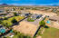 Endless possibilities for your animals, toys or out building to live in a gorgeous custom home on over an acre near Riggs & Higley.