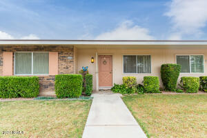 Retire in style here in Sun City! Beautiful front yard maintained by the hoa