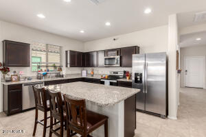 Kitchen with granite and island