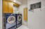 Laundry Room with Washer & Dryer & Ironing Board Cabinet