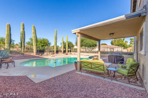 Oasis-like yard with huge pool, mature landscaping, covered & uncovered patio, mountain views, with park beside and behind