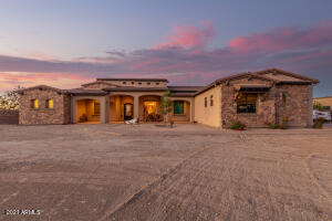 5 bedroom Custom home on 1.25 Acres in Queen Creek.  No HOA.  Soaring 14' to 16' ceilings throughout.  New Trane, SEER 14 HVAC system just installed.  Travertine flooring in all rooms except bedrooms.  Kitchen with granite countertops, full backsplash, stainless steel appliances, wall oven and microwave, R/O and breakfast bar at island is open to breakfast room and family room.  Fireplaces in family room and master bedroom.  Formal dining room.  Entryway opens to Formal Living Room and overlooks rear patio and heated salt water pool & spa.  Generous paved patio at rear.   Attached 4 car garage plus detached 1500 SF garage/workshop building which includes 220V electrical, welding plugs and water at exterior of building.  Custom RV gates on both sides of property grant access to the rear. Open space available for you to add guesthouse, horse facilities or additional storage/garage buildings. Additional items include added insulation and radiant barrier in attic, Surround Sound in Family Room and Back Patio, Security System, Privacy wall around Pool/Spa and Patio areas, fire and 2 water features at pool, Wet Bar with fridge in Family Room and walk-in closets in all bedrooms.  5th bedroom has double door entry and could be utilized as a home office or den.  Master Suite has large walk-in closet which is plumbed for stackable washer/dryer units.  Walk-in shower and jetted tub are in master bathroom.  Block-out Sunscreens are stored int he garage.  Roll down Shade on rear patio.  Custom Front Door opens to let in the fresh air.