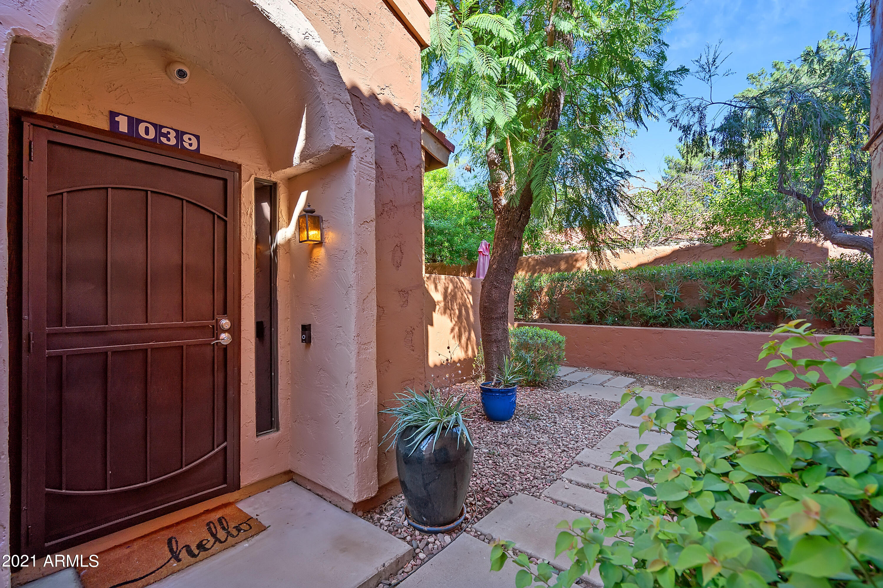 Welcome home to this stunning Scottsdale condo! Upon entering you'll find soaring ceilings, loads of light, and upgrades galore! Luxury vinyl flooring, upgraded counters, and new appliances are just a few! The open concept living space is perfect for entertaining, and there's even a private patio for dining alfresco. The bedrooms are generously sized, with plenty of space! Both bathrooms are resort like, you basically will never have to leave! Last but not least, you have a private two car garage, big enough to park two cars and have a good amount of storage! Schedule your showing today, this one won't last!