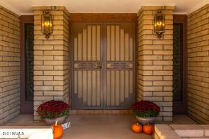 Custom Screen Doors greet you at the entry.