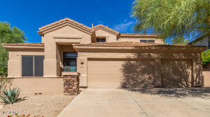 Front Elevation with new easy care desert landscaping