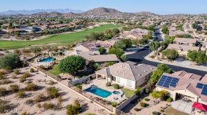 Gated neighborhood, backing to the golf course. 4 Bedrooms, 2 Bathrooms, 3 Car Garage. Pool, spa, putting green and entertainer's covered patio with awning extension.