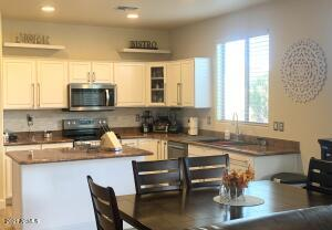 Spacious eat in kitchen, granite countertops, new stainless steel appliances.