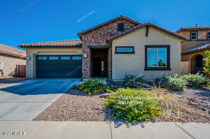 Built in 2015, this Gilbert one-story home offers an in-ground pool, a patio, granite countertops, and a three-car garage.