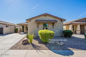 Built in 2011, this Gilbert one-story home offers granite countertops, and a two-car garage.