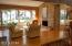 Family room with fireplace and vaulted ceiling - waterfront view