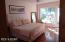 Master bedroom with en suite bath - waterfront view