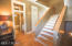 Lovely foyer with grand staircase leading to lower or third levels.