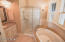 Master bath, separate toilet room and vanity with step-in shower.