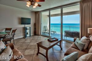 Spacious living area with a magnificent view and floor to ceiling sliding glass doors.