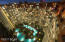 Nightime View of 18,000 sqft Beachfront Pool