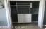Custom closet shelving in guest bedroom 1