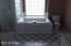 Master bathtub and separate shower with ceramic tile