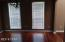 Separate dining room with wood laminate flooring