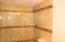 Spacious Tile Shower in the Hallway Bathroom.