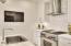 Gourmet Kitchen with Subway Tile Backsplash