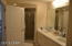 Master bathroom offers a separate walk in shower, double vanity as well as large soaking tub.