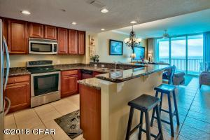 The kitchen offers ample counter and cabinet space. With a wrap around breakfast bar offering additional casual dining options, this layout is ideal for relaxing after a day on the sandy beaches.