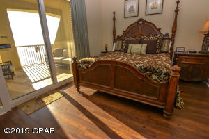 Spacious owner's suite with private balcony access.
