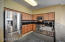 Kitchen with granite counter tops and step up bar area