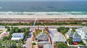 Zoned Multi-Family, this home with separate Carriage house, on is situated on a corner, fenced site directly across from a 2,500 foot private beach !