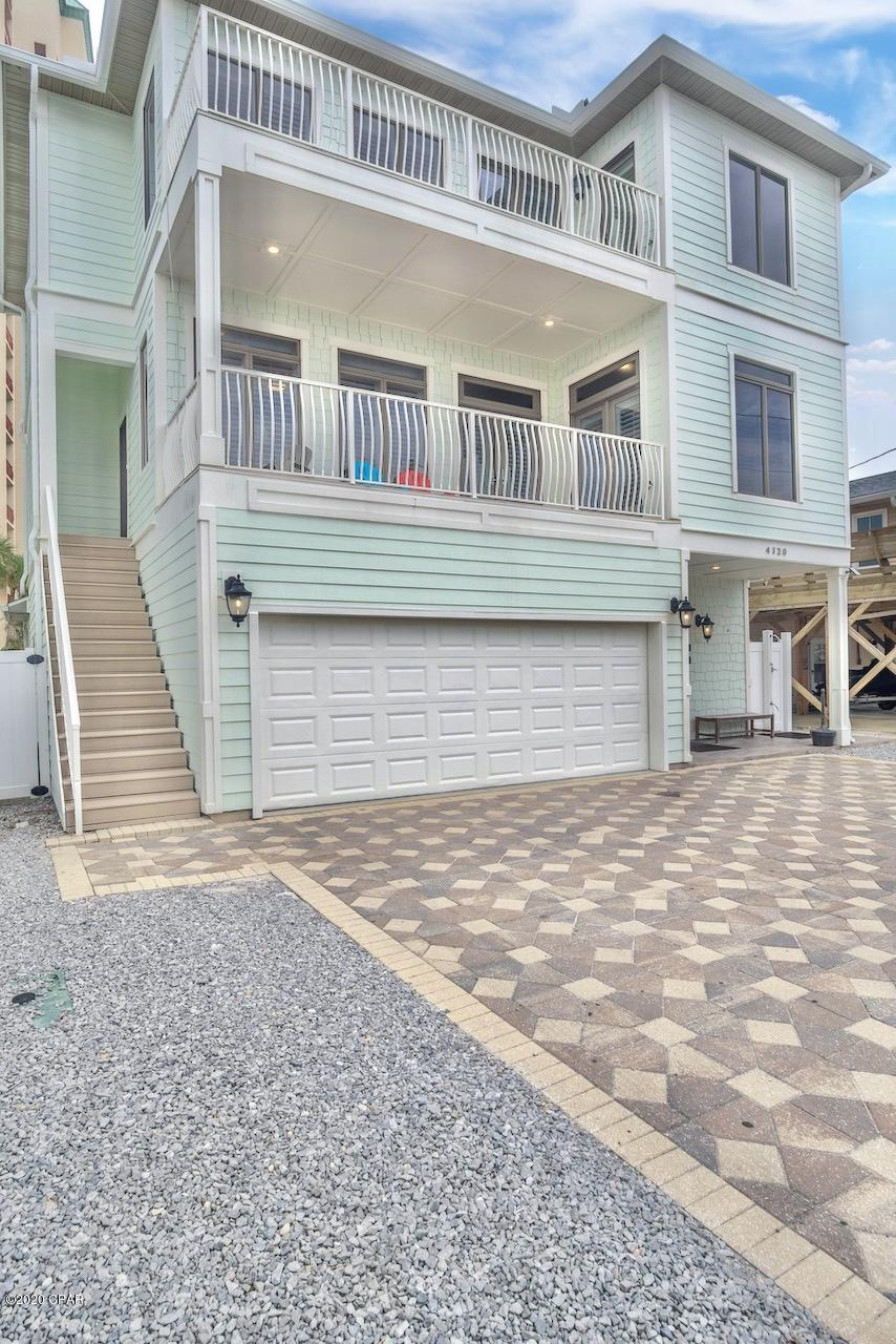 Reward yourself with this 3 story 7 bedroom, 4 bathroom beach home! Rare opportunity for all beach l