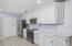 All new stainless steel appliances compliment this beautifully renovated kitchen