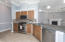 Fully equipped Kitchen, stainless steel appliances, gas stove
