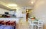 Breakfast bar, dining and kitchen areas