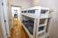 Build in bunks between guest bedrooms 3rd level