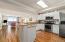 The Kitchen, Dining Area & Living Room share an Open & Bright Space.