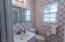 Full bath near kitchen and laundry room