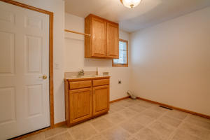 Laundry room off of garage.