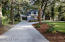 Large driveway with direct approach to carport