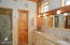 master bath his and her sinks, steam shower and private commode