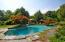 resort gunite pool full of sun, shade and beautiful plantings