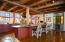 kitchen with custom cabinetry, wood flooring,huge island, pantry,