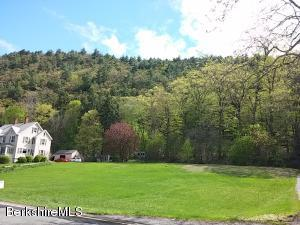 Open lot with woods behind and views over Rising Pond.