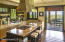 THE KITCHEN COOKING ISLAND AND ADJOINING SCREENED PORCH