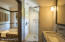 MASTER BATH HAS LOCAL MARBLE SLAB COUNTERS AND TILES