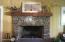 Raised hearth stone fireplace