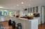 Kitchen with marble counters.