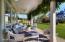 The Main House veranda is off the family room. Mature wisteria.